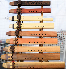 Traditional Native American Indian flutes on display for sale at a powwow, San Francisco