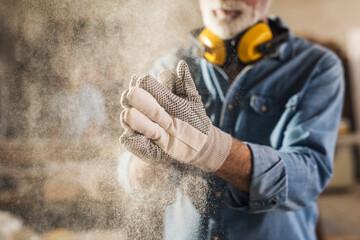 Carpenter cleaning work gloves