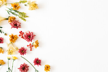 Autumn floral composition. Frame made of fresh flowers on white background. Autumn, fall concept....