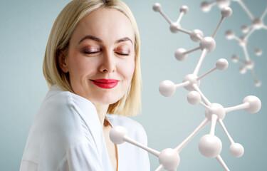 Beautiful adult woman near big white molecule chain.