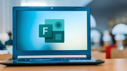 Laptop computer displaying logo of Microsoft Forms