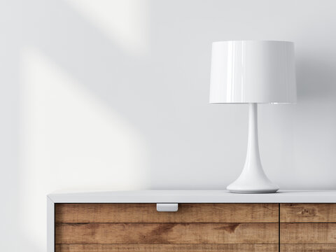 Modern white lamp on cabinet with clean wall mockup