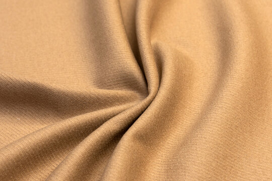 Expensive velour beige fabric, cashmere textile, velvet suede and chamois effect, cotton upholstery, synthetic materials, polyester fiber.