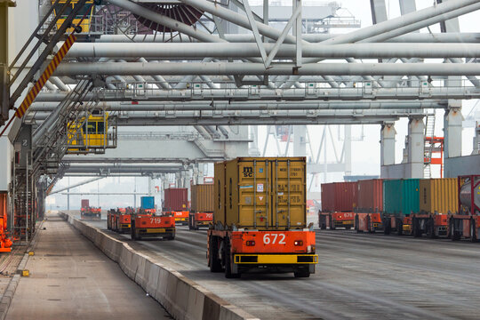 Automated vehicles moving shipping containers to and from gantry cranes in the Port of Rotterdam, The Netherlands, September 6, 2013.