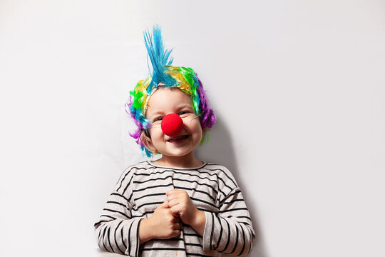 girl in clown costume with red nose