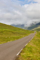 Faroe islands picturesque road surrounded by green fjord landscape