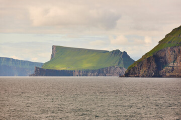 Stora Dimun dramatic island in Faroe archipelago. Atlantic ocean