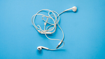 Wall Mural -  Headphones on blue background