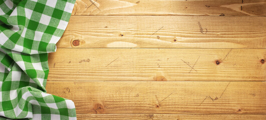 cloth napkin at old wooden plank board table background