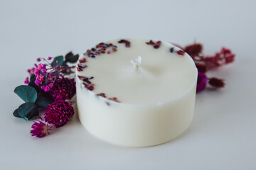 Fototapeta Eco soy wax candles with dried flowers and fruit. Aromatherapy, scented decorative candle.  obraz