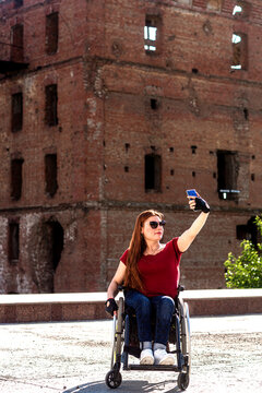 A girl with disabilities at the historical monument.