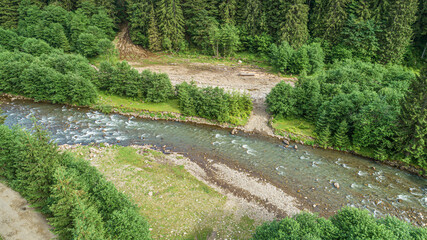 Forest and river from a bird's eye view. Photo from the drone. Carpathians.