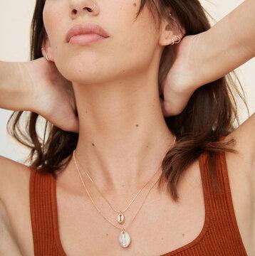Woman wearing shell jewellery closeup