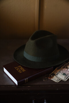 Hat on Bible and money