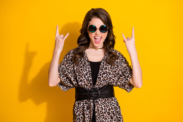 Portrait of positive excited girl enjoy rejoice weekend concert show horned symbol wear good look outfit isolated over bright color background