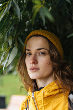 Portrait of a young girl in a yellow beanie hat