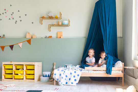 Two Toddler Girls Playing at Bedroom