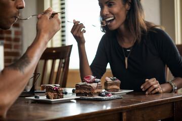Loft: Friends Celebrating Birthday With Chocolate Cake