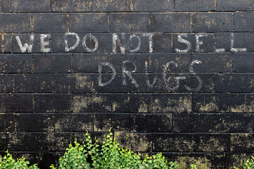 Painted sign deterring the selling of drugs