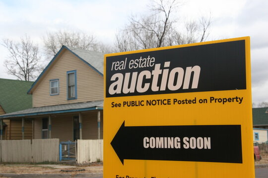 Real Estate Auction Sign. Economic Downturn during Layoffs and Pandemic lead to people losing there homes because they cannot pay the mortgage to the bank.