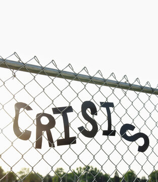 Crisis Words on Fence Border