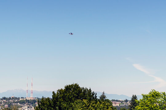 Panoramic view of the Olympic mountain range opposite Seattle and a partial view of the Queen Anne neighborhood in Seattle with its radio towers.