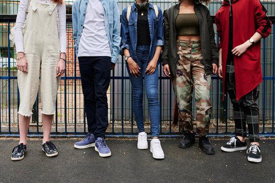 Faceless group of teens.