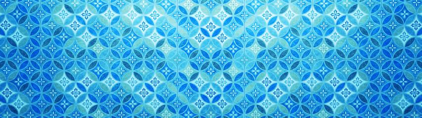 Old blue aquamarine pastel vintage shabby patchwork mosaic motif tiles stone concrete cement wall...