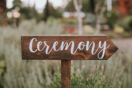 Wooden Sign Pointing to Wedding Ceremony