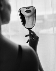 Anonymous Woman Looking at Herself in Mirror