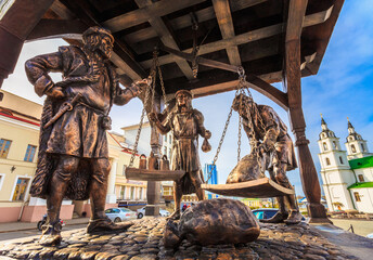 Trade merchants weighing of the wares and payment - bronze statue in old part town - Trinity Hill In Minsk, Belarus
