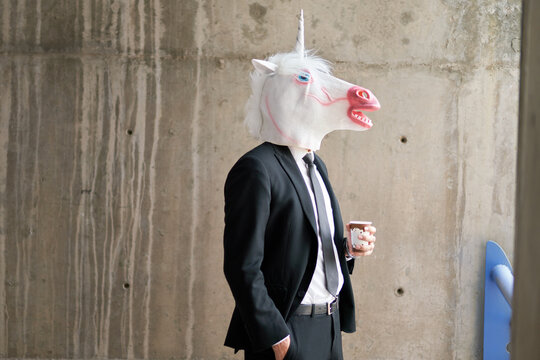 Unicorn in a suit with coffee cup