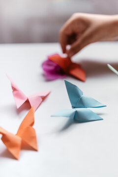 Origami butterflies on a white table