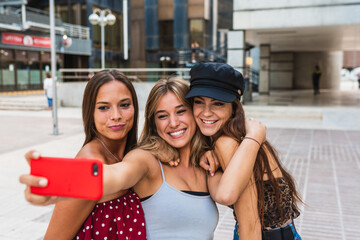 group of girlfriends taking pictures.