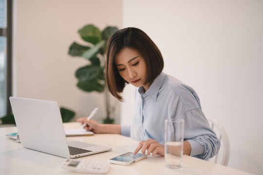 Asian businesswoman working with modern devices