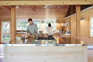 Multi-ethnic couple in farmhouse kitchen
