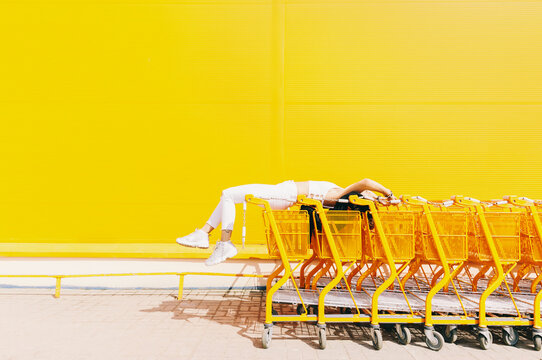 Woman with shopping carts