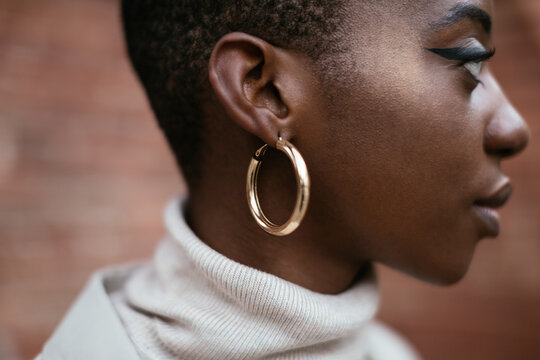 Black woman with shiny earring