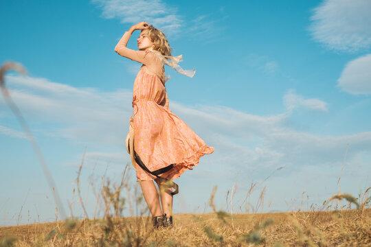 Stylish Blond Woman Wearing Pink Silk Dress Outdoors