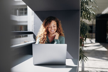 Smiling businesswoman in an office Wall mural
