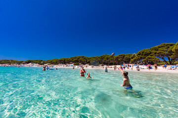 CALA AGULLA, MALLORCA, SPAIN - 21 July 2020: People enjoying summer on the popular beach on...