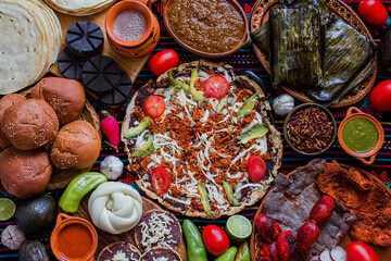 traditional Mexican food from Oaxaca Mexico, Tlayuda, Oaxaca Cheese, tamales and Chocolate