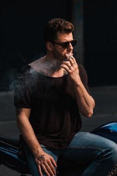 Man Dressed In Black Smoking A Cigarette