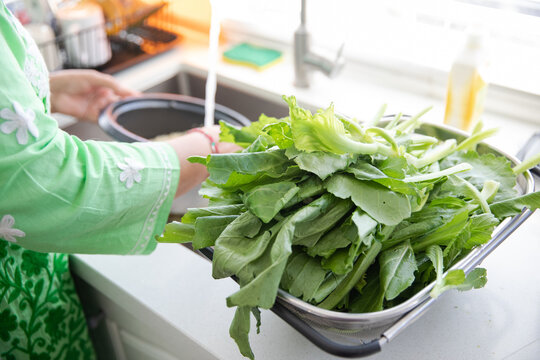 Details of leafy greens in a kitchen.