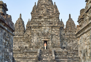 Foto op Canvas Historisch mon. Woman at the gate of an ancient temple in Prambanan Temple, Java, Indonesia