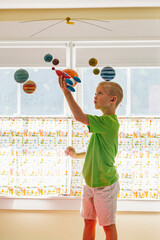 Solar System Mobile with boy Playing with Rocket Shi