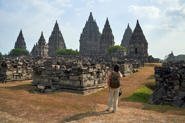 Foto op Canvas Historisch mon. Back view of woman with backpack looking at Prambanan Temple, Java, Indonesia