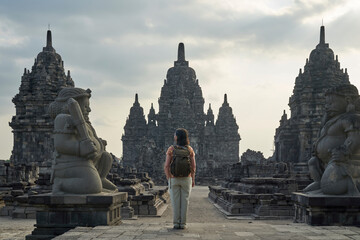 Foto op Canvas Historisch mon. Back view of woman with backpack standing in the entrance of an ancient hindu temple in Prambanan Temple, Java, Indonesia
