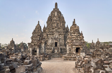 Foto op Canvas Historisch mon. Woman with backpack standing in front of the gate in Prambanan Temple, Java, Indonesia.