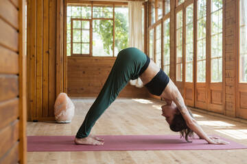 Young woman yoga workout indoors